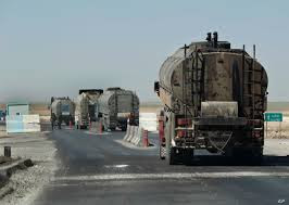 US occupation forces bring out 49 tanks loaded with stolen oil from Syria