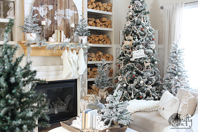 Neutral Christmas living room decor. Wood and white Christmas decor. Boho style Christmas decor. Bohemian style Christmas tree. Beaded and macrame Christmas tree decor and decorating ideas. How to decorate a Christmas tree. Farmhouse style Christmas decor. Wood and White Christmas mantel decor. Vintage Christmas mantel ideas. Flocked Christmas trees. Two story living room design.