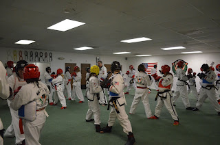 Kids martial arts class where the kids are all sparring and learning
