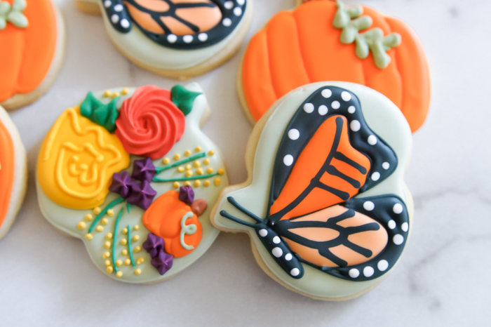 pumpkin, butterfly, and floral cookies for fall...made from ONE cookie cutter!