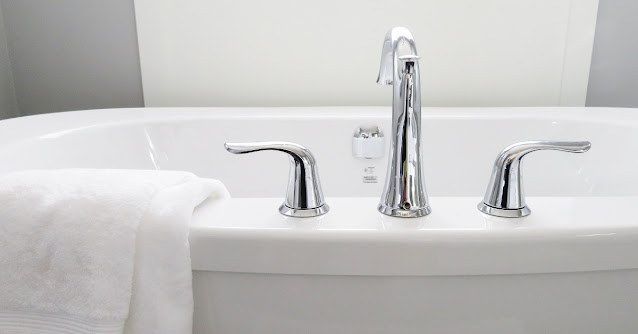 Bathtub with water-saving faucet.
