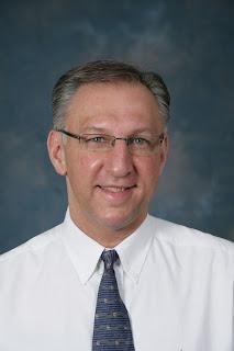 Dr. Karl Benzio