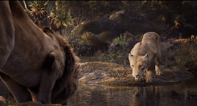 The Lion King 2019 movie still where Beyonce's Nala and Donald Glover's Simba drink water out of a lake and sing Can You Feel the Love Tonight together
