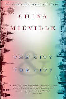 Two city skylines, each on the left and right sides of the book cover with an empty space between.