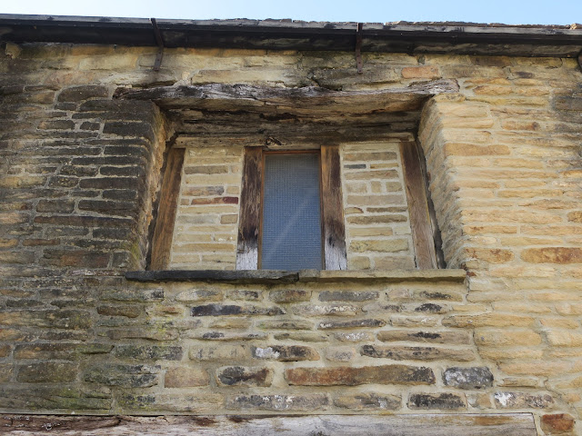 Window narrowed by old wood and old bricks. Sowerby Bridge. Calderdale. 12th May 2021.