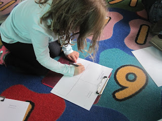 Student working on living and nonliving
