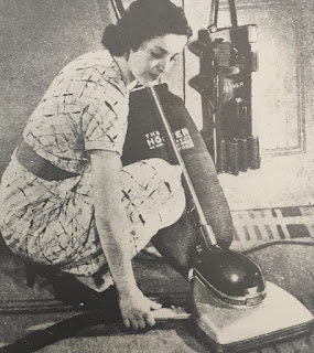 A 1930s photo of a woman and a vaccuum cleaner