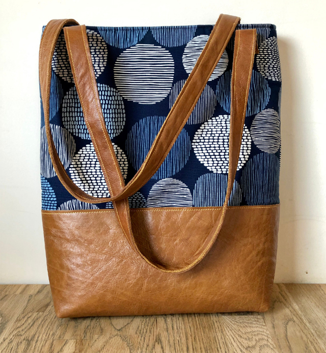 Learn how to make a lined, leather and fabric tote bag with padded tablet pocket. Tutorial by Vicky Myers Creations.