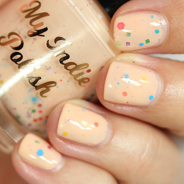 peach nail polish with rainbow glitters