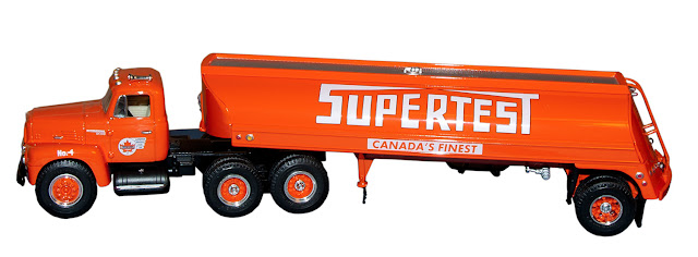 A large tanker truck in orange with Supertest logo.