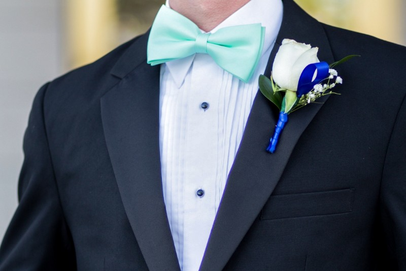 Man wearing Tuxedo suit with pleated tuxedo shirt.