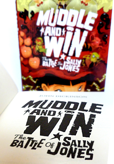 Muddle and Win - Photo of one book open to the title page, with another copy standing behind it