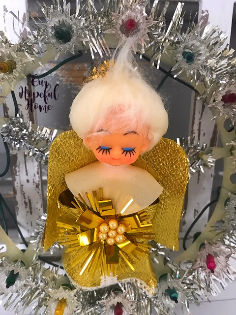 cherubic angel golden wings pearls tinsel lights