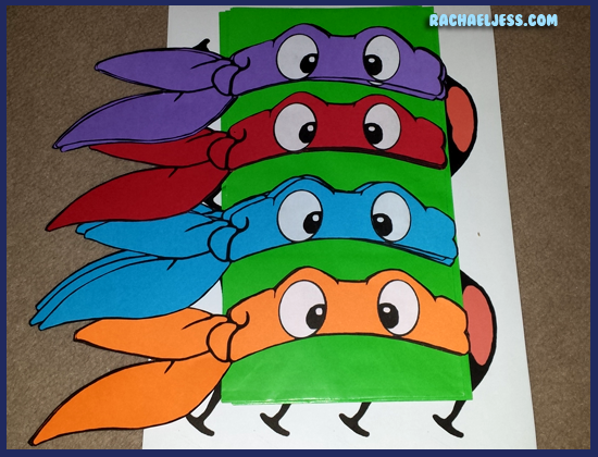 Using coloured card and white sticky paper for the TMNT masks