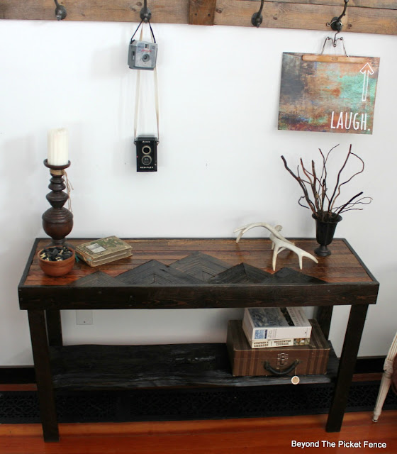 Table with a mountain design made from reclaimed wood
