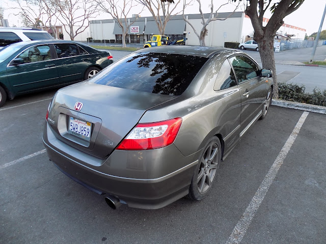 Faded paint on Honda Civic Si before respray at Almost Everything Auto Body.