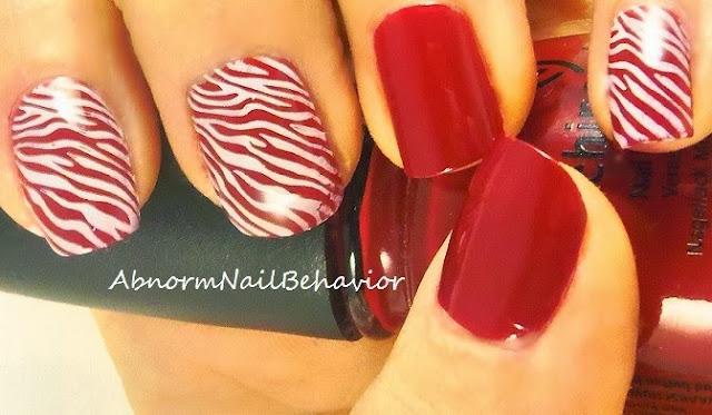 fun red and white zebra nails