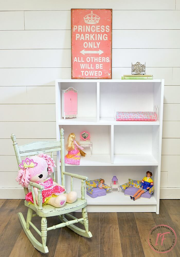 An adorable IKEA Billy Bookcase Dollhouse Bookcase and how to add a pitched roof, real hardwood floors, black & white checkerboard and papered floors.