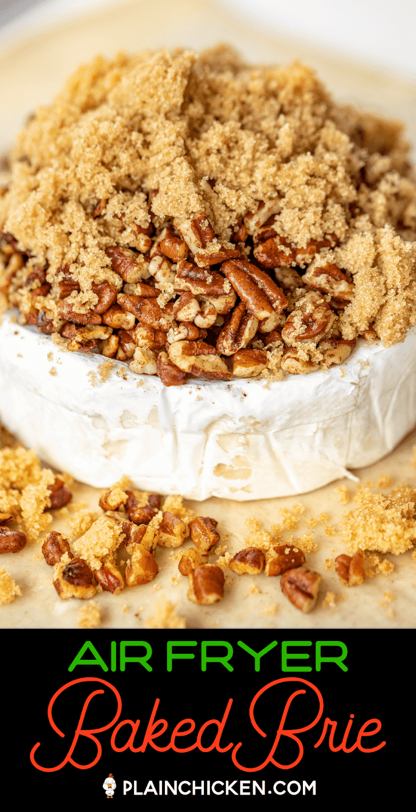 brie cheese wheel topped with brown sugar and pecans