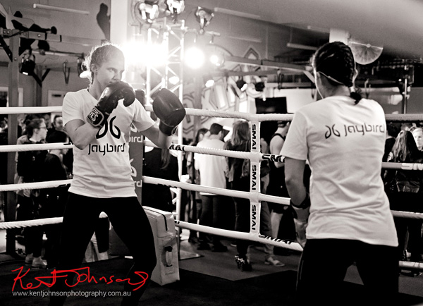 Two women sparing at Boxing Works Kings Cross for the Jaybird Freedom launch. Photo by Kent Johnson for Street Fashion Sydney.