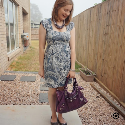 awayfromblue Instagram | spring office outfit paisley print sheath dress purple bag balenciaga work
