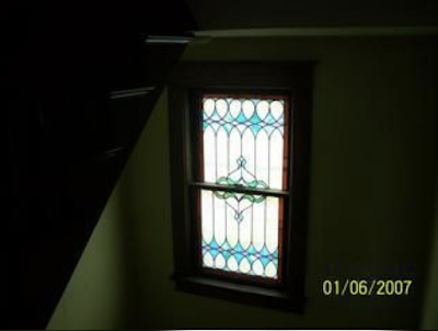 color photo of stained-glass window in staircase of Sears No 137, 40 4th Street, Canisteo, New York