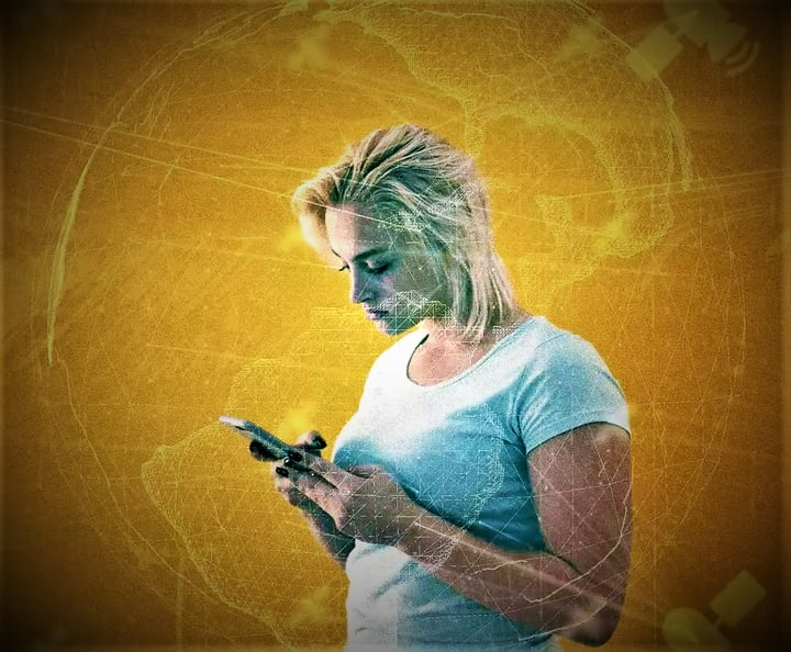 A woman stands with a cellphone in her hand, reading an article on the history of the time.