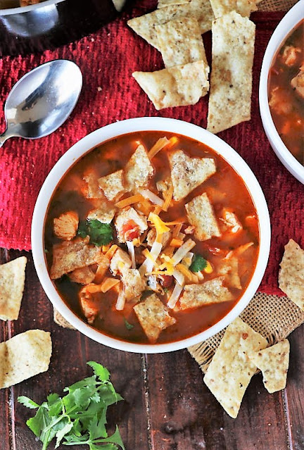 Bowl of Chicken Tortilla Soup Topped with Crumbled Tortilla Chips Image