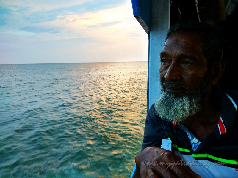 An old man looks on during boat ride in Rameswaram, Tamil Nadu