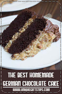 The BEST homemade German Chocolate Cake with layers of coconut pecan frosting and chocolate frosting. This cake is incredible! #cake #homemade #chocolate