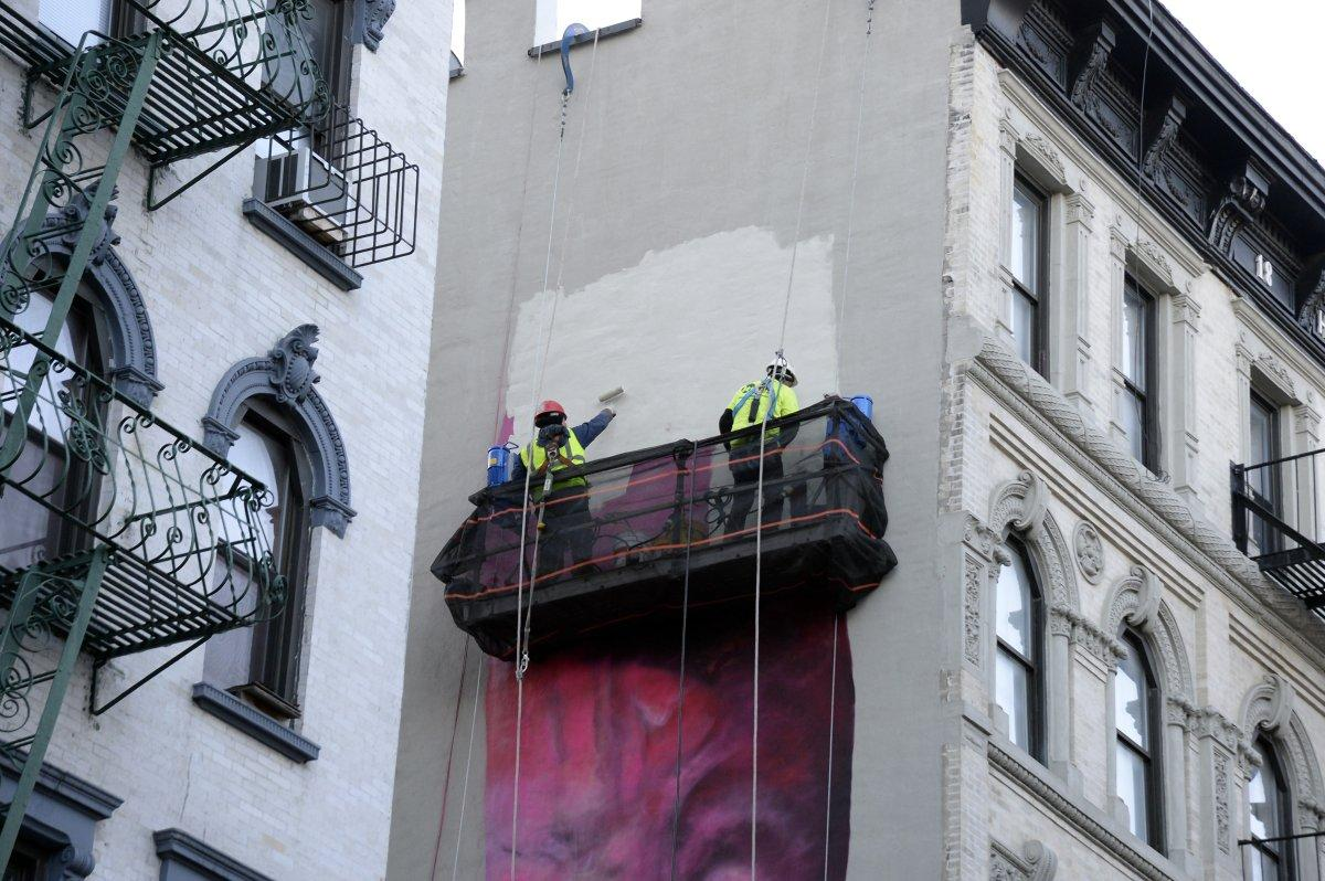 Artist faces backlash for painting giant penis on building for Mural on broome street