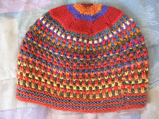simple hat knit with knits, purls and slipped stitches. Colorful knit hat.
