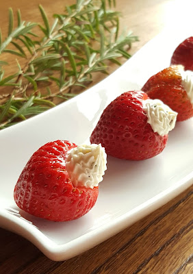 California strawberries filled with fresh goat cheese make a delicious low-carb appetizer