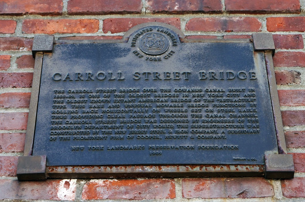 Carroll Street Bridge information plaque featured on wall above entrance to operator's house.