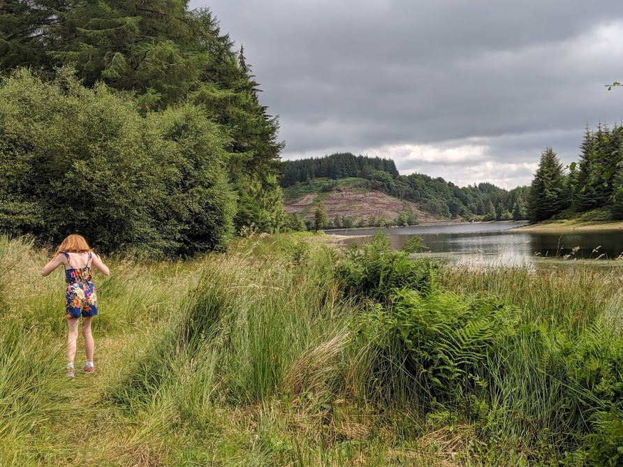 The Three Lochs Forest Drive - A Good Spot for Wild Camping with Kids  - playing by loch