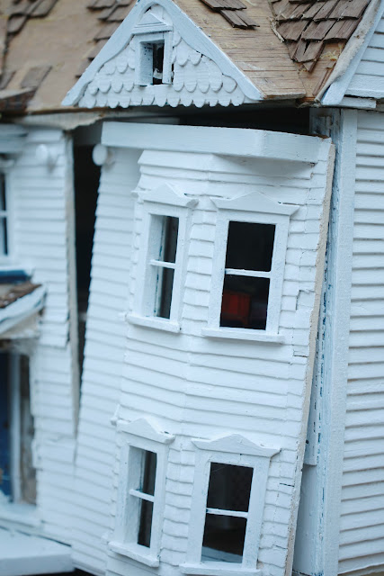 bay windows on door to vintage doll house