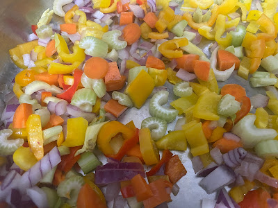 Cooking the colorful peppers, onion, carrots and celery.