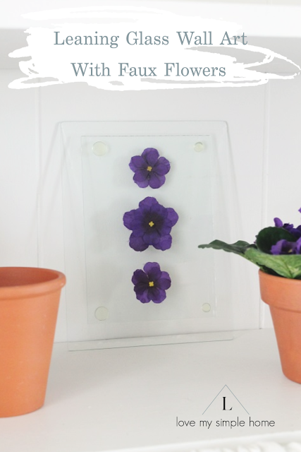 leaning-glass-wall-art-with-faux-flowers-love-my-simple-home