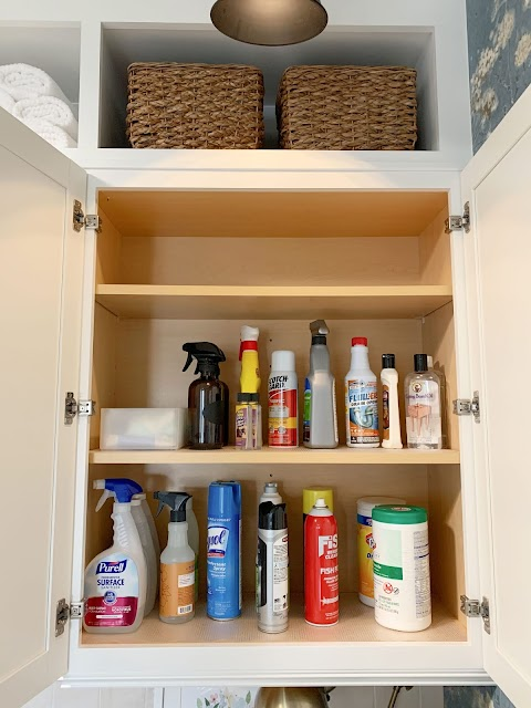 cleaning supply organization in cabinet