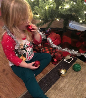 Child pretending to eat an ornamental bulb