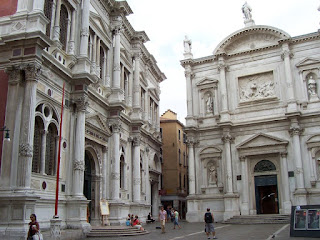 The Scuola Grande di San Rocco (left) adjoins the  Church of San Rocco in Venice in the San Polo district