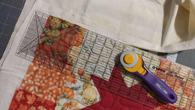 Trimming the quilt before binding