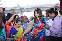 Puja Hegde looks stunning in Red saree at launch of Anutex shopping mall ~ Celebrities Galleries 086.JPG