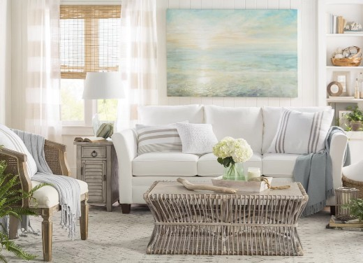 Coastal Living Room Decor Idea with Ocean Art above Sofa