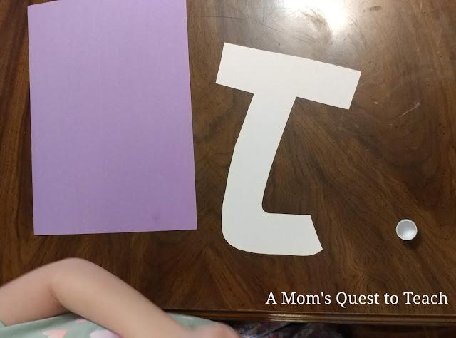 letter J upside (made of construction paper); glue stick; purple construction paper