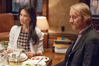 Rhys Ifans as Mycroft Holmes with Lucy Liu as Joan Watson in CBS Elementary Season 2 Episode 7 The Marchioness