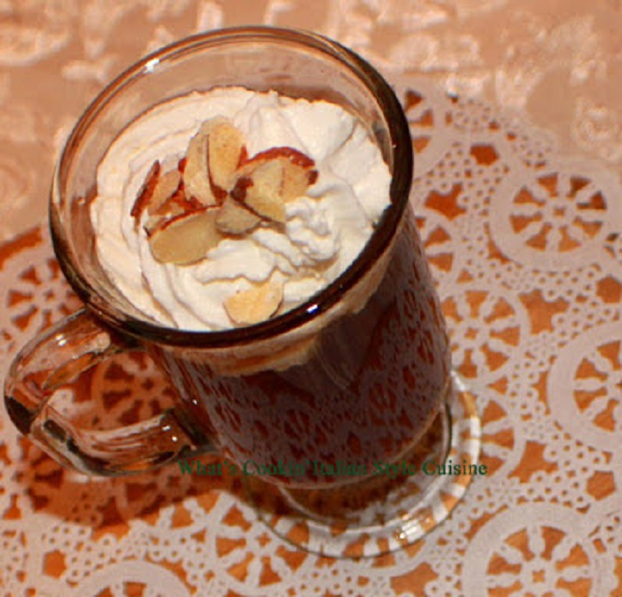 this is coffee with Amaretto and Kahlua Liqueurs topped with cream and almonds
