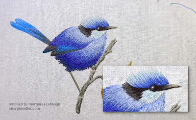 Thread painted blue bird with highlight added to eye
