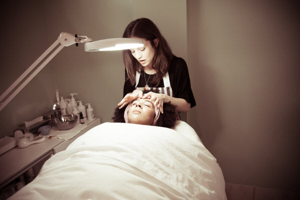 Kathryn Sawers of Collective Skincare in Vancouver, BC, Canada, doing a facial on a client