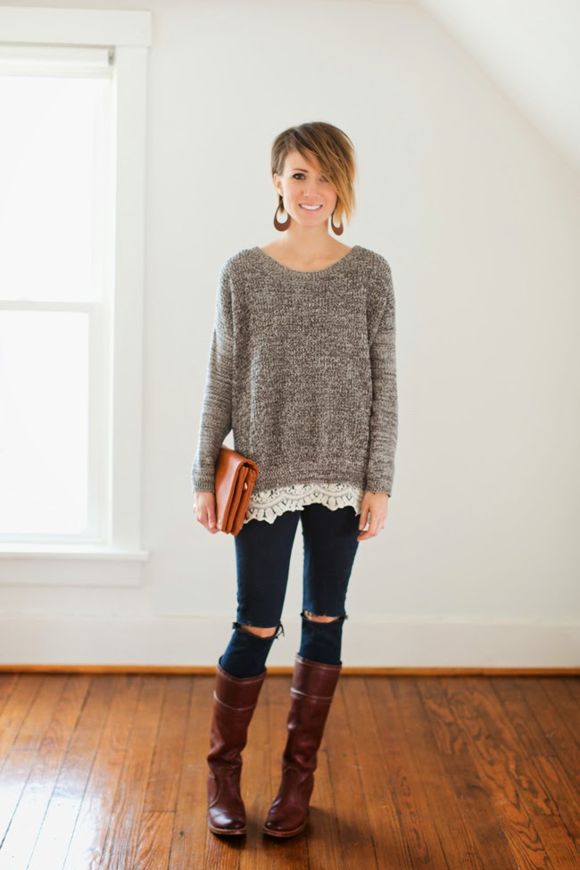 Lace trimmed sweater, black destroyed denim and tall boots